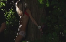 Gina Gerson tied up in forest