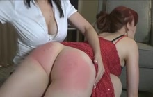 Lesbians spanking each other