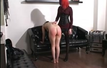 Red haired girl spanking her slave